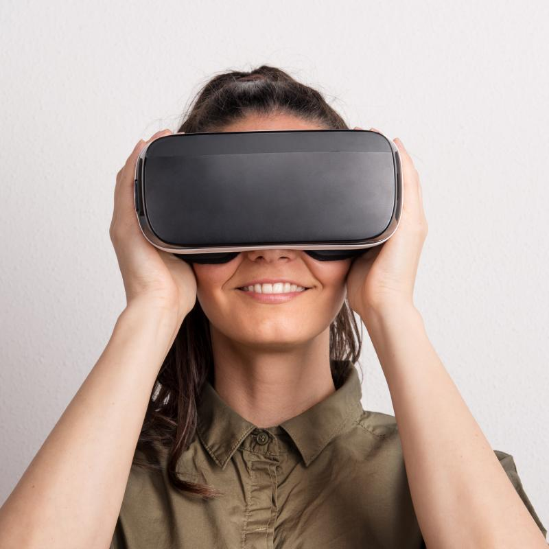 Happy woman wearing VR headset